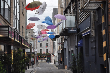 Umbrellas over street, Dublin, Ireland. Photo by David Wineberg