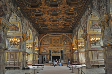 Grand ballroom with costumed children visitors, Chateau Fontainebleau, Fontainebleau, France. Photo by David Wineberg