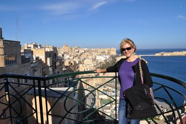 Nancy at high wall, overlooking Valletta, Malta. Photo by David Wineberg