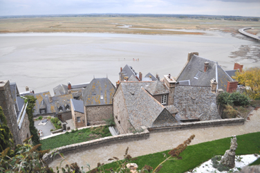 People walking the bay at low tide, Mont Saint-Michel, Normandy, France. Photo by David Wineberg